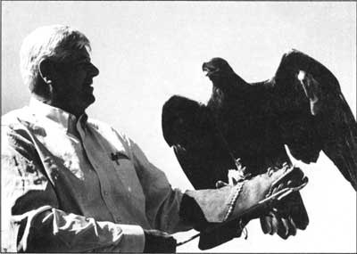Rogers Morton of Maryland holding bird on his arm