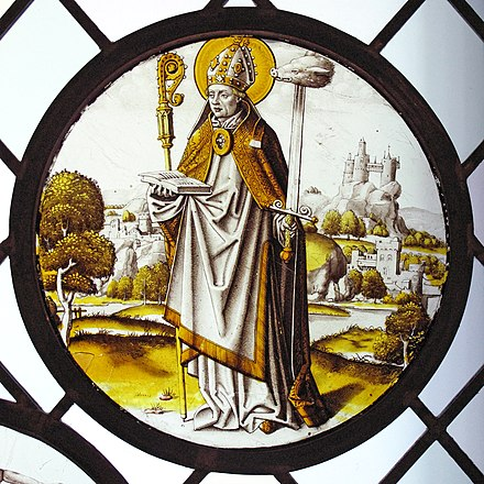 Renaissance roundel, inserted into a plain glass window, using only black or brown glass paint, and silver stain in a range of yellows and gold. The local bishop-saint Lambrecht of Maastricht stands in a extensive landscape, 1510-20. The diameter is 8 3/4 in. (22.2 cm), and the piece was designed to be placed low, close to the viewer, very possibly not in a church. Roundel with Saint Lambrecht of Maastricht MET cdi32-24-48.jpg
