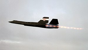 Afterburner - SR-71 Blackbird in flight with J58 engine on full afterburner, with numerous shock diamonds visible in the exhaust