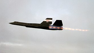 Afterburner - SR-71 Blackbird in flight with J58 engines on full afterburner, with numerous shock diamonds visible in the exhaust.