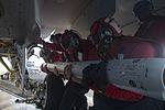 Sailors load ordnance on an F-A-18E Super Hornet. (27961461405).jpg
