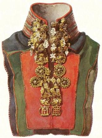 Gákti - A goldwork collar of a traditional Sámi woman's gákti i.e. a national garment (regalia) from Scandinavia. This gákti has a metal embroidery collar with pewter or silver thread and traditional Sámi silver buckles.