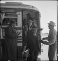 San Bruno, California. Evacuees of Japaneses ancestry arriving at the Tanforan Assembly center. Th . . . - NARA - 537492.tif