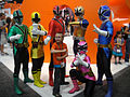 San Diego Comic-Con 2011 - Power Rangers pose with kids (Nickelodeon booth) (5976789471).jpg