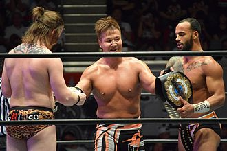 NEVER Openweight 6-Man Tag Team Championship - (Left to right) David Finlay, Satoshi Kojima and Ricochet upon winning the title in September 2016