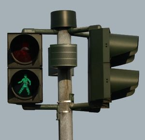Pedestrian crossing light with loudspeaker for...