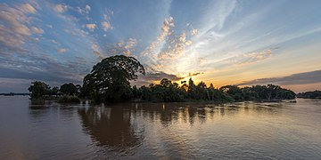 Silhouette of an island at sunrise with colorful clouds in Don Det Si Phan Don Laos.jpg