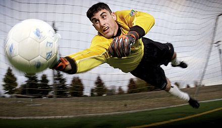 Goalkeeper diving to keep the ball away from goal Soccer goalkeeper.jpg