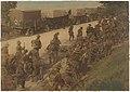 Soldiers on roadside beside trucks (13940970316).jpg