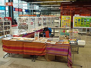 "Abdullahi Yusuf Ahmed - Copies of Ahmed's autobiography Halgan iyo Hagardaamo: Taariikh Nololeed (""Struggle and Conspiracy: A Memoir"") and other books on display at the 2012 Somali Culture Fair in Helsinki."
