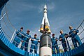 Soyuz MS-06 crew and backup crew at the Soyuz rocket monument behind the Cosmonaut Hotel.jpg