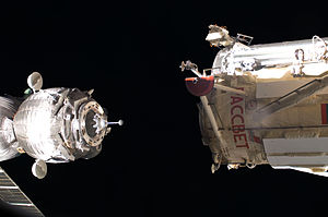 Docking and berthing of spacecraft - Soyuz TMA-03M docking with MRM-1 Rassvet in Earth orbit, bringing three crew to the International Space Station in December 2011.