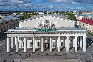 Old Saint Petersburg Stock Exchange and Rostral Columns - Portico of the Old Saint Petersburg Stock Exchange (Bourse) showing the sculpture of Neptune