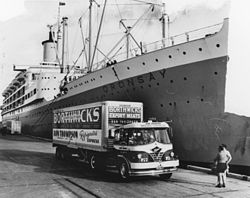StateLibQld 1 137220 Borthwick's export meat truck alongside the Oransay at a Brisbane wharf.jpg