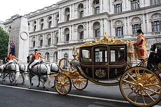 Diamond Jubilee State Coach - In use at the 2014 State Opening of Parliament, postillion-driven with 3 pairs of Windsor Grey horses.