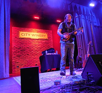 Steve Earle - Steve Earle performing on a mandolin at the City Winery Chicago in February 2015