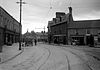 Street scene, possibly in Dublin with carts, cyclists and tramlines! (16202791867).jpg