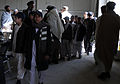 Students file into a hangar at the Afghan Air Force's Kandahar Air Wing, in Kandahar province, Afghanistan, Jan. 1, 2012 120101-A-EL067-001.jpg