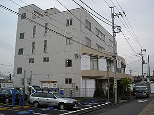 Gainax - Gainax's offices in Koganei, Tokyo, circa 2004. The studio since moved to a modest two-story premise, also in Koganei, before moving again to another premise.