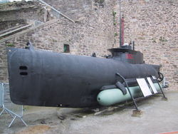 German midget submarine Seehund, with a torpedo