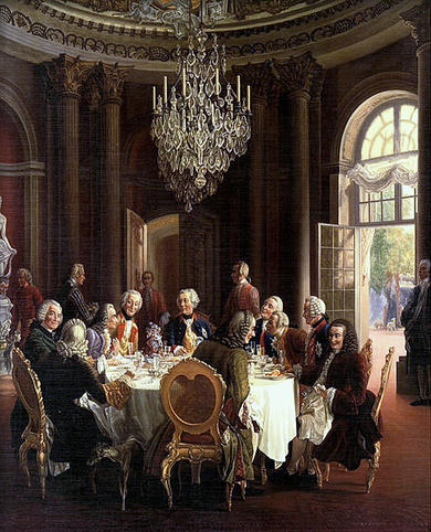 Die Tafelrunde by Adolph von Menzel: guests of Frederick the Great at Sanssouci, including members of the Prussian Academy of Sciences and Voltaire (third from left) Tafelrunde.PNG