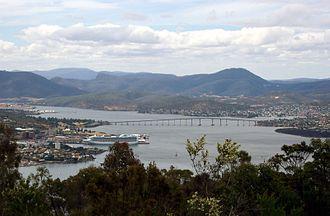 History of Hobart - Hobart (on the left) is centred around Sullivans Cove, at which a cruise ship is docking.