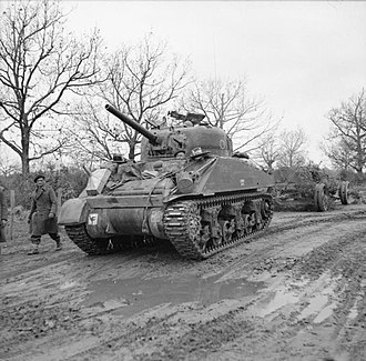 23rd Armoured Brigade (United Kingdom) - A Sherman tank of the 46th Royal Tank Regiment towing a German 155mm gun, captured by the 2nd Battalion, North Staffordshire Regiment, 23 January 1944. The gun was a vintage First World War French piece.