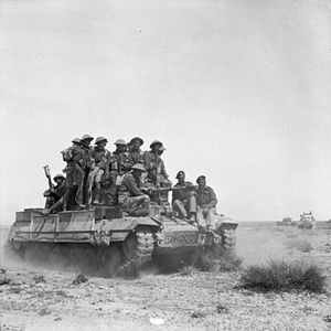 23rd Armoured Brigade (United Kingdom) - A Valentine tank of the 50th RTR carries infantrymen of the 5th Battalion, Black Watch during an exercise, 12 March 1943.