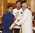 The President, Shri Pranab Mukherjee presenting the Padma Shri Award to Shri Shekar Naik Lachma, at a Civil Investiture Ceremony, at Rashtrapati Bhavan, in New Delhi on March 30, 2017.jpg