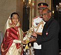 The President, Smt. Pratibha Devisingh Patil presenting the Padma Bhushan Award to Shri Shyam Saran, at an Investiture Ceremony II, at Rashtrapati Bhavan, in New Delhi on April 01, 2011.jpg