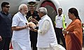 The Prime Minister, Shri Narendra Modi being received by the Governor of Rajasthan, Shri Kalyan Singh and the Chief Minister of Rajasthan, Smt. Vasundhara Raje Scindia, on his arrival, at Udaipur, in Rajasthan.jpg