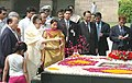 The Prime Minister of Bangladesh, Ms Khaleda Zia scatters rose petals at the Samadhi of Mahatma Gandhi at Rajghat in Delhi on March 21, 2006.jpg