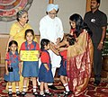 The school children tying 'Rakhi' to the Prime Minister, Dr. Manmohan Singh, on the occasion of 'Raksha Bandhan', in New Delhi on August 13, 2011. Smt. Gursharan Kaur is also seen.jpg