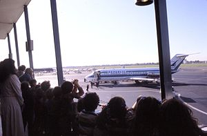 Tour group at John Wayne Airport, 1981.jpg