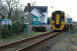 Train leaving Talsarnau station - geograph.org.uk - 674297.jpg
