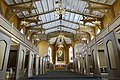 Tromsø Cathedral (domkirke) Norway interior. Nave (skipet), gallery, choir, altar, pews (kirkebenker), chandeliers, timber roof truss (takstoler), etc Wooden Gothic Revival style church 1861 2019-04-04 DSC02278.jpg