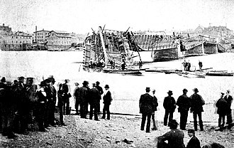 Dixon Bridge Disaster - The Dixon (Ill.) Truesdell Bridge Collapse, May 1873. View: looking south.