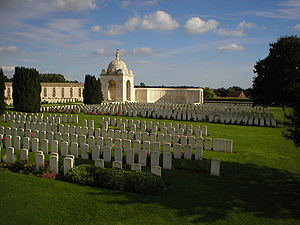 Tyne Cot - The walls forming the memorial in the background, with one of the rotundas