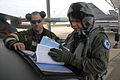 U.S. Air Force Senior Airman Jay Bicknell, left, with the 169th Aircraft Maintenance Squadron, and Maj. Christopher Rachael, from the 157th Fighter Squadron, conduct post flight checks on an F-16 Fighting Falcon 080412-F-WT236-026.jpg