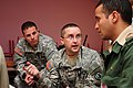 U.S. Army Capt. Enoch D. Christopherson, center, a physician assistant with the Utah State Medical Command, Utah Army National Guard, speaks to an interpreter while working at a humanitarian civic assistance 120413-A-QD330-109.jpg