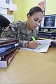 U.S. Army Cpl. Natasha Hunter, a staff judge advocate paralegal with the 4th Infantry Division and Regional Command South, researches regulations at her office at Kandahar Airfield, Afghanistan, Sept 130901-A-RY828-344.jpg