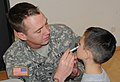 U.S. Army Spc. Dustin Seland assigned to 2D Stryker Cavalry Regiment, administers the flu mist to Patrick Blake at Vilseck Elementary School, in Vilseck, Germany, Nov. 2, 2011 111102-A-XC710-334.jpg