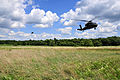 U.S. Army UH-60 Black Hawk helicopters prepare to land during rescue hoist training near the Chesapeake and Delaware Canal in New Castle County, Del., Aug. 4, 2013 130804-Z-DL064-603.jpg