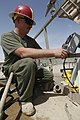 U.S. Marine Corps Cpl. Jonathan M. Klindt, a heavy equipment mechanic with Marine Wing Support Squadron 271, mounts a control box onto a skid-mounted hydro seeder at Camp Leathernec in Helmand province 130401-M-BU728-041.jpg