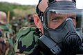 U.S. Marines, of III Marine Expeditionary Force, participate in chemical, biological, radiological and nuclear (CBRN) training where Marines conduct a series of tests while wearing their protective gear before 111222-M-LY681-014.jpg