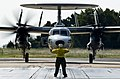 U.S. Navy Aviation Boatswain's Mate (Handling) 2nd Class Christina Irwin, assigned to Air Test and Evaluation Squadron (VX) 23, directs an E-2D Hawkeye aircraft assigned to VX-1 on the flight line at Naval Air 130827-N-OY799-286.jpg