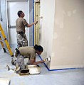 U.S. Navy Petty Officer 2nd Class Phillip Diaz, standing, and Petty Officer 2nd Class Shanta Karpf paint a wall at the Warrior Recovery Center at Bagram Airfield, Afghanistan, May 8, 2013 130508-D-EN552-462.jpg