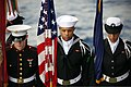 U.S. Sailors and a Marine with a color guard stand in formation during a burial at sea March 19, 2013, aboard the amphibious assault ship USS Kearsarge (LHD 3) in the Atlantic Ocean 130319-N-UM734-198.jpg