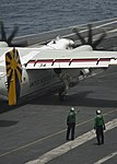 U.S. Sailors direct the movement of arresting gear June 19, 2013, after landing a C-2A Greyhound aircraft assigned to Fleet Logistics Support Squadron (VRC) 30 on the flight deck of the aircraft carrier USS 130619-N-LP801-064.jpg