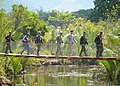 U.S. Service members with the Combined-Joint Civil Military Operations Task Force walk across a new bridge built as part of Balikatan 2013 after a ribbon cutting ceremony in Tapuac, Philippines, April 17, 2013 130417-N-VN372-002.jpg